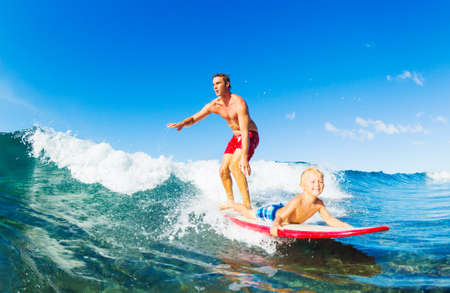 sand surfing: Father and Son Surfing Together