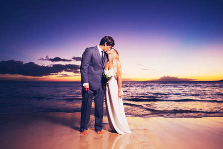 wedding dress silhouette: Beautiful Wedding Couple, Bride and Groom Kissing on the Beach at Sunset