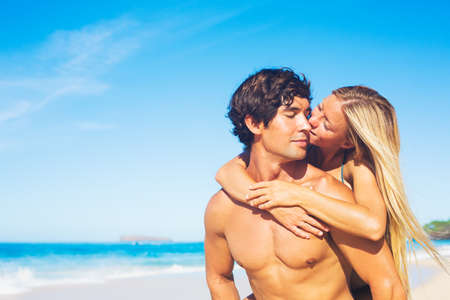 bikini couple: Attractive Couple Kissing on Sunny Beach Vacation