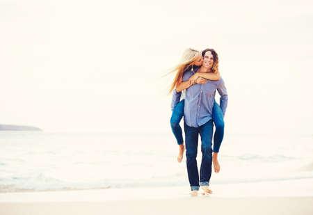 Young Romantic Happy Couple Enjoying Walk on the Beach photo