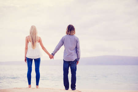 Romantic Young Couple on the Sea Shore