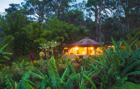 getaways: Tropical Cabin Retreat in the Jungle at Sunset Stock Photo