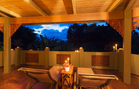 water hottub: Beautiful Romantic Deck on Tropical Home at Sunset with Candles Stock Photo