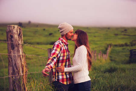 hand on hip: Romantic Young Couple in Love Outdoors Stock Photo