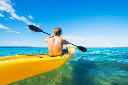 kayak: Man Kayaking in the Tropical Ocean Stock Photo