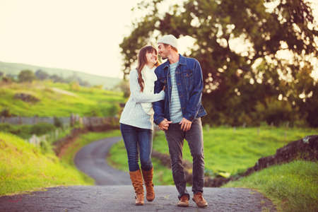 romantic couples: Romantic Young Couple in Love Outdoors on Country Road