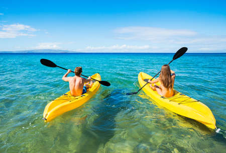 hawaii: Couple Kayaking in the Ocean on Vacation