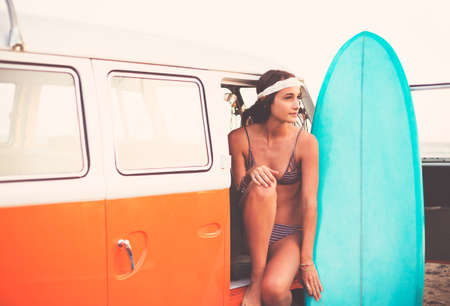 beach: Beach Lifestyle, Beautiful Surfer Girl with Classic Vintage Surf Van on the Beach at Sunset