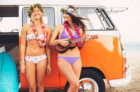 leis: Beautiful Surfer Girls with Ukulele and Flower Leis hanging out on the Beach at Sunset with Classic Vintage Surf Van