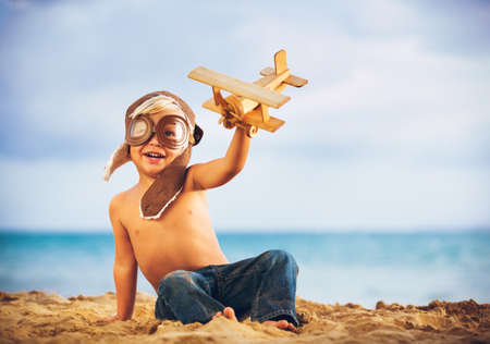 children at play: Small Boy Playing with Toy Airplane