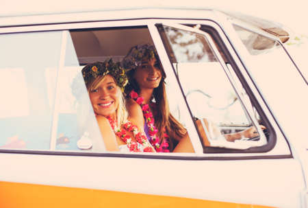 surfing: Beach Lifestyle. Beautiful Young Surfer Girls Having Fun Hanging Out in Vintage Surf Van. Best Friends.