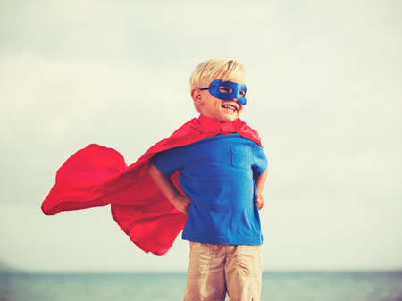 vintage children: Superhero Kid, Young Happy Boy Playing