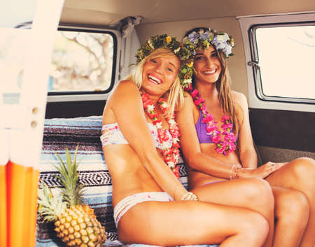 surf girl: Beach Lifestyle. Beautiful Young Surfer Girls Having Fun Hanging Out in Vintage Surf Van. Best Friends.