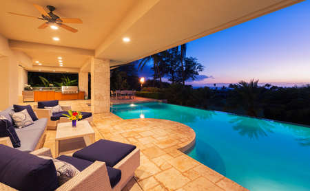 tropical sunset: Beautiful Luxury Home with Swimming Pool at Sunset