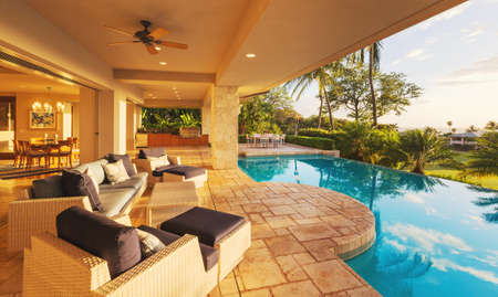 deck chairs: Beautiful Luxury Home with Swimming Pool at Sunset