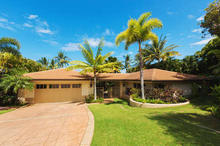 residential home: Tropical Luxury Home, Exterior View with Green Lawn and Driveway
