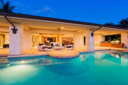 home entertainment: Beautiful Luxury Home with Swimming Pool at Sunset