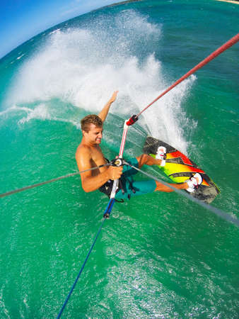 people in action: Kite Boarding. Fun in the ocean, Extreme Sport. POV View from Action Camera. Stock Photo