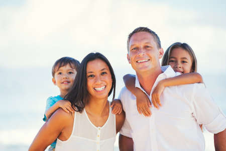 hawaii: Portrait of Young Happy Family Stock Photo