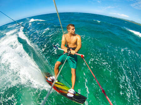 water sports: Kite Boarding. Fun in the ocean, Extreme Sport. POV View from Action Camera. Stock Photo