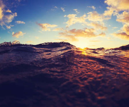 sea wave: Ocean Waves at Sunset.  Abstract View of Water and Sky at Sunset. Stock Photo