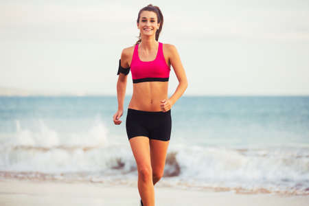 active lifestyle: Healthy Active Lifestyle. Young sports fitness woman running on the beach at sunset.
