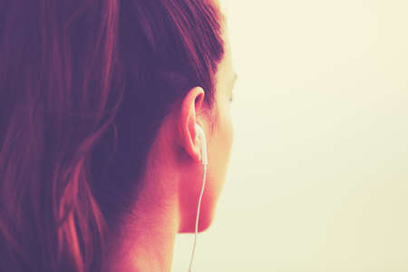 woman: Active Sports Lifestyle with Modern Technology. Young fitness woman listening to music