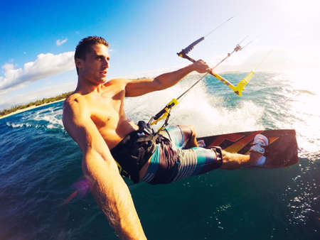 fun: Kiteboarding. Fun in the ocean, Extreme Sport Kitesurfing. POV Angle with Action Camera