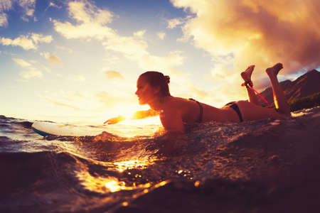 surfing wave: Surfing at Sunset. Outdoor Active Lifestyle.