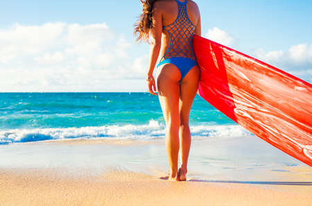 thong woman: Beautiful Surfer Girl on the Beach at Sunset. Summer Fun Outdoor Lifestyle.