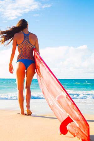 girls in bikini: Beautiful Surfer Girl on the Beach at Sunset. Summer Fun Outdoor Lifestyle.