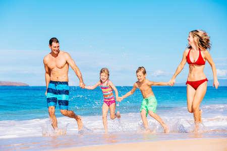 beach holiday: Happy family having fun on beautiful warm sunny beach.