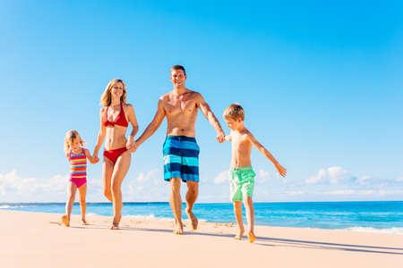 Family vacation. Happy family having fun on beautiful warm sunny beach. Summer lifestyle 版權商用圖片 - 44689024