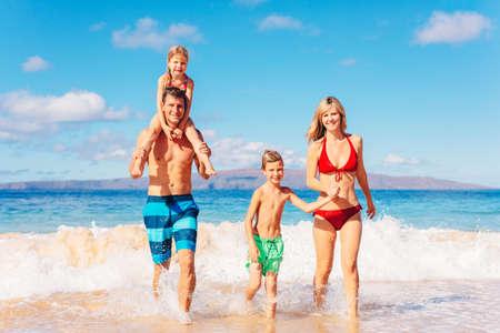 Family vacation. Happy family having fun on beautiful warm sunny beach. Outdoor summer lifestyle.