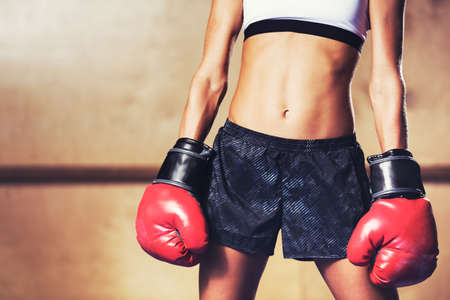 sexual: Beautiful Woman with the Red Boxing Gloves. Attractive Female Boxer. Stock Photo
