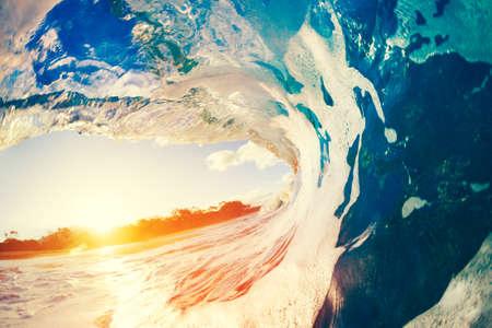 Blue Ocean Wave Crashing at Sunset Banque d'images