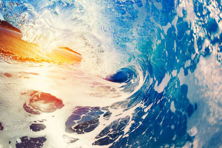 liquid summer: Blue Ocean Wave Crashing at Sunrise