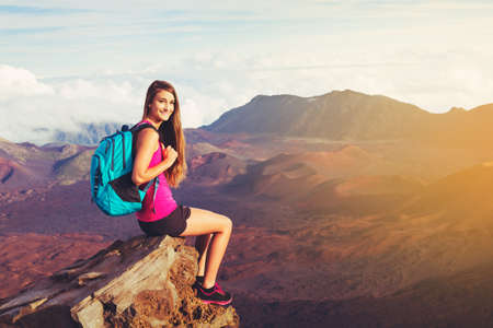 Young woman hiker in the mountains enjoying the outdoors Stock fotó