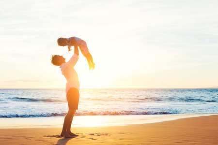 day dream: Happy Joyful Father and Son Having Fun Playing on the Beach at Sunset. Fatherhood Family Concept