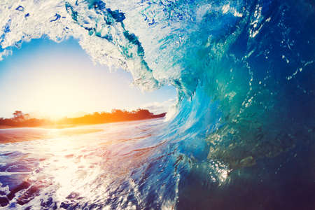 beach: Blue Ocean Wave Crashing at Sunrise