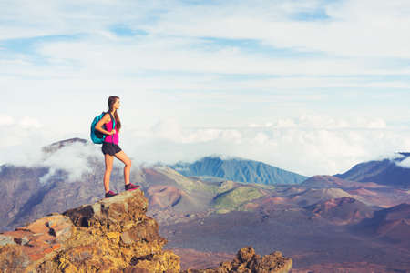sunrise mountain: Young woman hiker in the mountains enjoying the outdoors Stock Photo