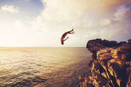Cliff Jumping into the Ocean at Sunset, Summer Fun Lifestyle Stock fotó - 48957999