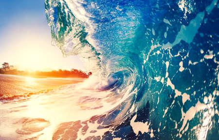 Blue Ocean Wave Crashing at Sunrise