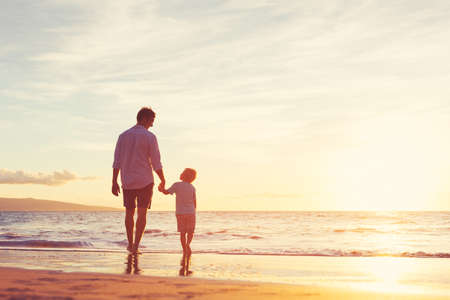 Father and Son Walking Together on the Beach at Sunset. Fatherhood Family Concept Stock fotó - 48958003