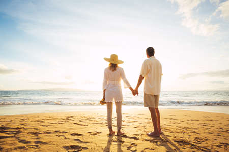 Happy Romantic Middle Aged Couple Enjoying Beautiful Sunset on the Beach. Travel Vacation Retirement Lifestyle Concept. Stock fotó - 49495455