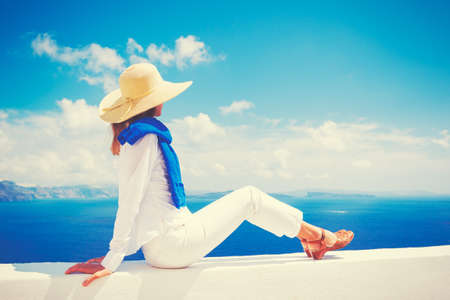 looking out: Travel Concept, Woman on Vacation Relaxing Looking out over the Sea in Europe
