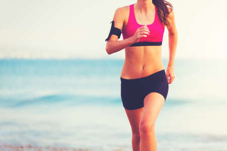 Fitness Woman Running by the Ocean at Sunset Stock fotó - 52133165