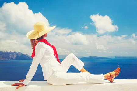 Travel Concept, Woman on Vacation Relaxing Looking out over the Sea in Europe