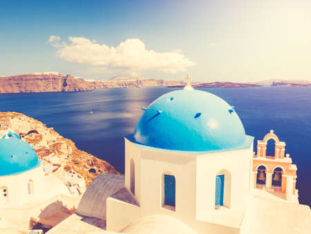 White Architecture and Blue Ocean, Santorini Island, Greece, View of caldera with domes at sunset Reklamní fotografie