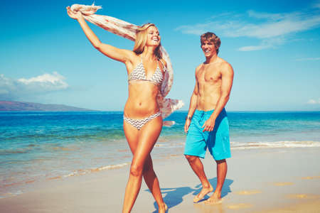 Happy Attractive Young Couple on Tropical Beach Banco de Imagens